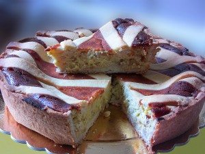 Naples, Italy - April 19, 2014: Neapolitan Easter pie, traditionally called Pastiera. You see also a slice of the cake