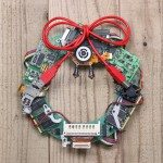 geeky christmas wreath made by old computer parts hanging on wooden door, computer parts recycling idea