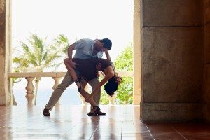 young hispanic couple dancing latin american dance outdoors. Horizontal shape, side view, full length