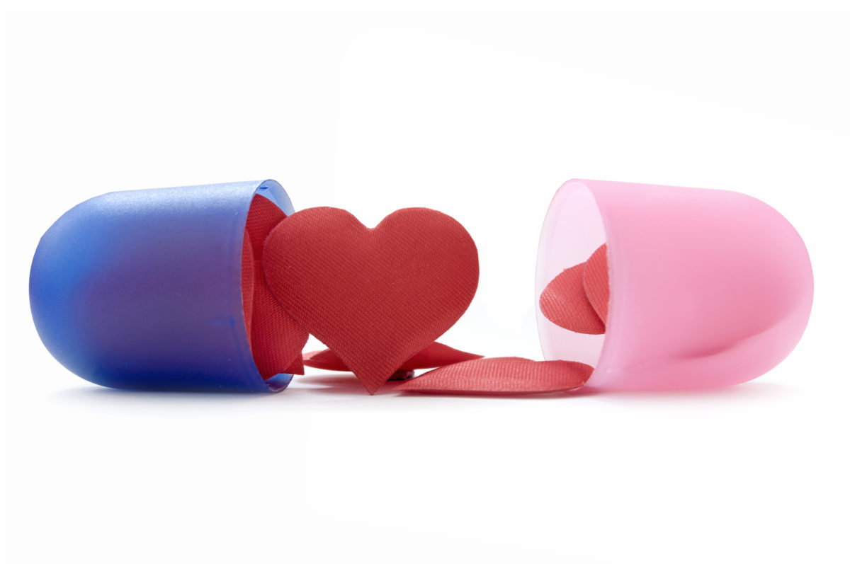 Heart shape pills inside a medicine pill capsule
