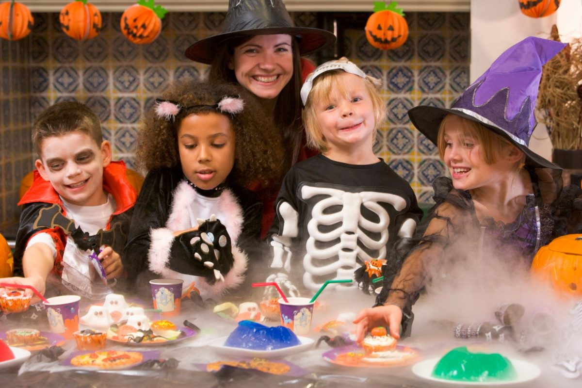 Group of Children Enjoying Halloween Party At Home