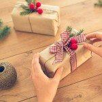 Woman decorating homemade Christmas gift.