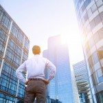 career concept, business background, man looking at office buildings