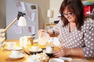 Mature Woman Making Candles At Home, Smiling