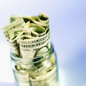 Close-up of a jar containing American dollar bills