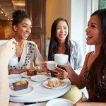 Group Of Happy Smiling Female Friends Meeting In Caf? Restaurant