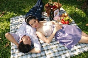 Beautiful happy couple on romantic picnic