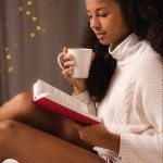 Image of female drinking warming winter tea in bed