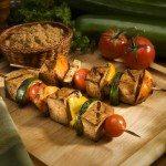 Barbecued Tofu and Vegetable skewers on Wood Background