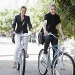 Businesswomen riding bicycles