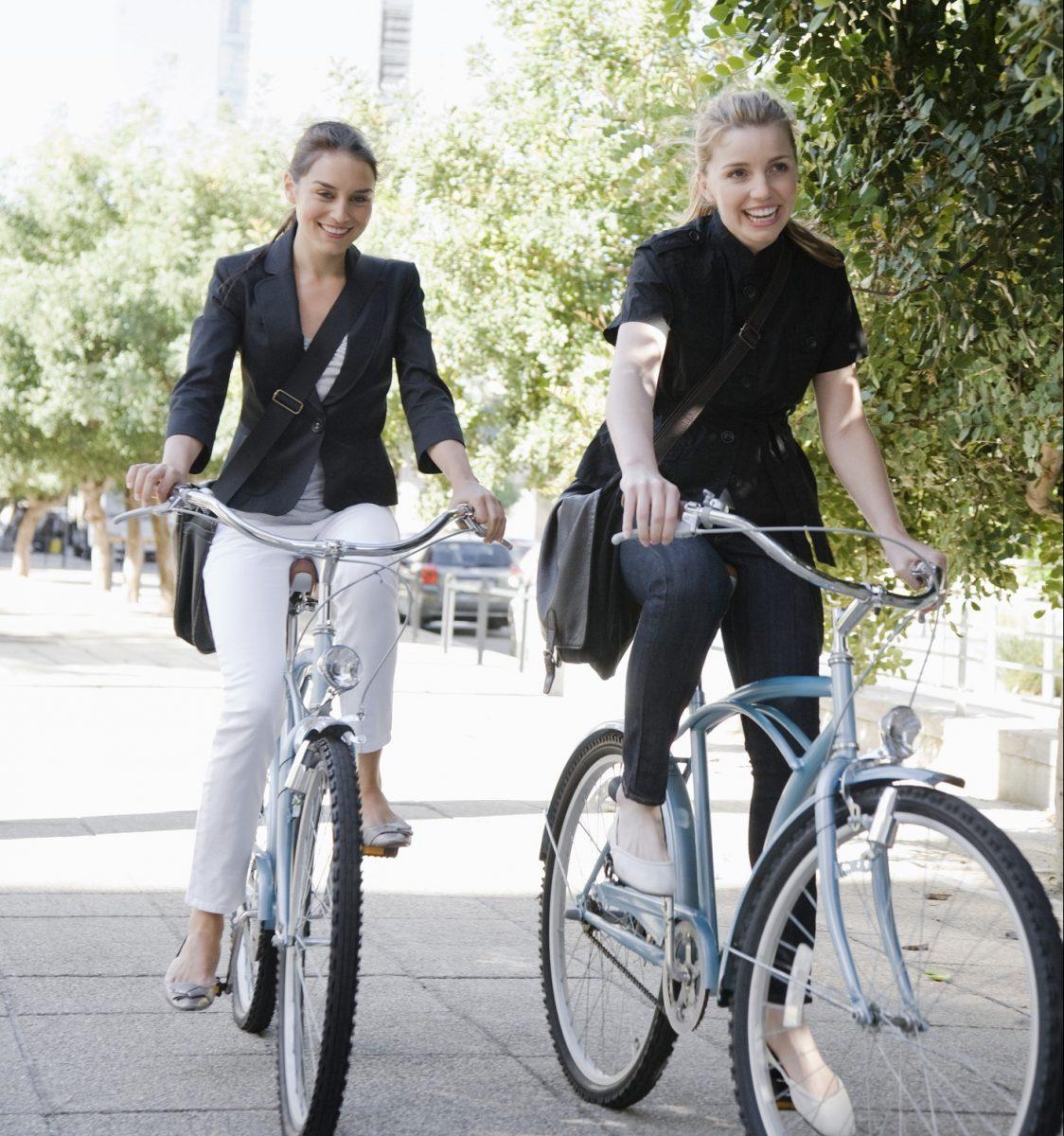 Businesswomen riding bicycles