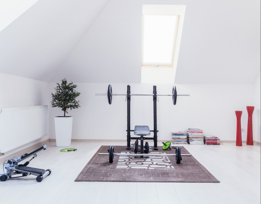 Small gym arranged in white room at home