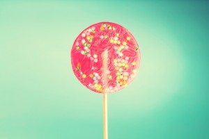 Giant lollipop on a blue pastel background